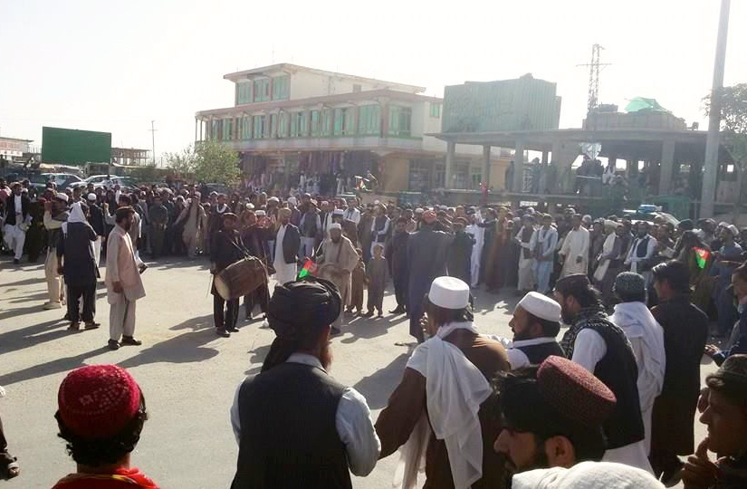 """People gather in Paktika to """"celebrate"""" the death of former ISI Chief Hameed Gul (Photo by Raouf Mohklis)"""